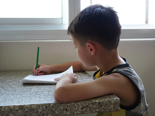 boy at same time and place to do homework
